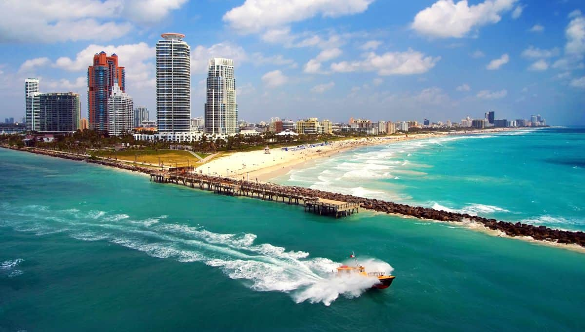 Aerial_view_of_South_Miami_Beach_with_Pilot_boat_sailing_next_to_the_city_line_terrenosnaflorida-com_shutterstock_224565427_1200x680